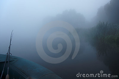 Going fishing in fog early at the morning