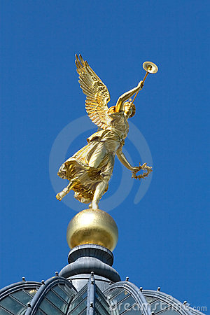 Gold angel on the blue sky