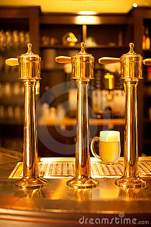 Gold beer spigot at the brewery