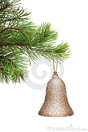 Gold bell hanging on a green Christmas tree branch