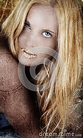 Gold blond woman on grunge.