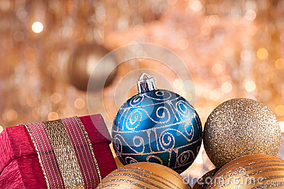 Gold and blue christmas baubles and red box