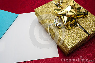 A Gold Box with Bow and Card