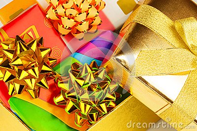 Gold box with gifts inside