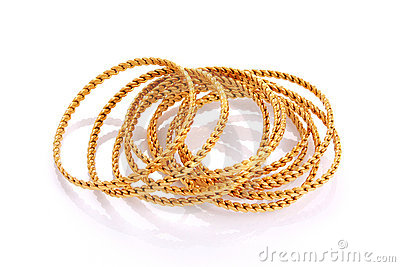 Gold bracelets isolated on white