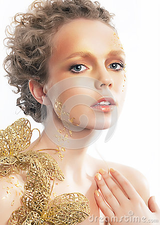 Gold bright make-up. Beauty woman face. Creativity