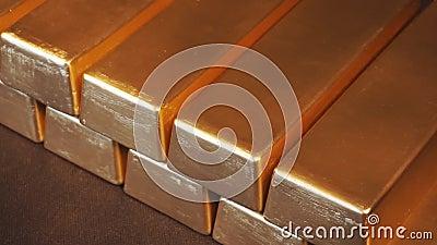 Gold bullion bars. Moving stacks of gold bars
