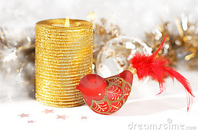 Gold candle with decorative bird
