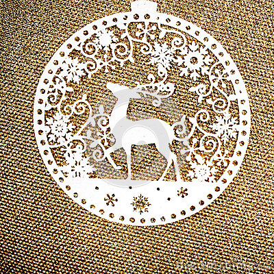 Gold Christmas background with white Christmas Ornament. Holiday