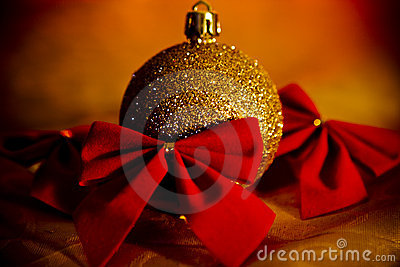 Gold Christmas ball with red bows