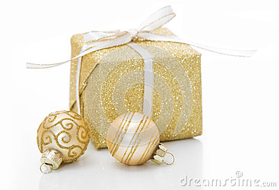 Gold Christmas gift box with bauble decorations isolated on whit