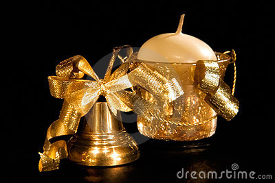 Gold christmas handbell and candle