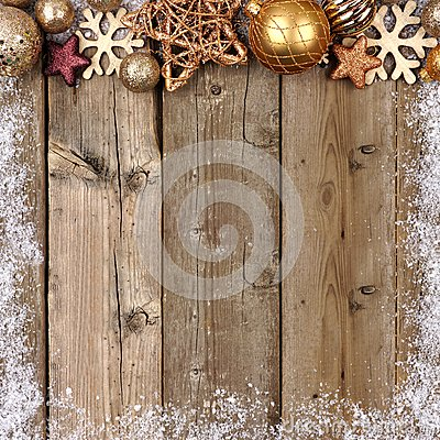 Free Gold Christmas Ornament Top Border With Snow Frame On Wood Stock Photo - 79337140