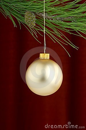 Gold Christmas ornaments on burgundy background
