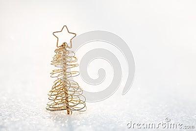 Gold Christmas tree decoration on snow