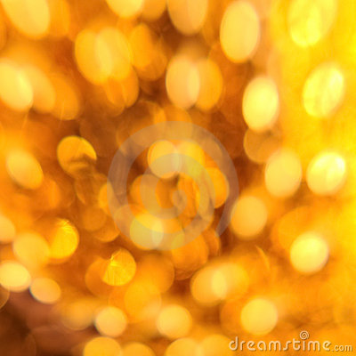 Gold circles of light abstract background blur