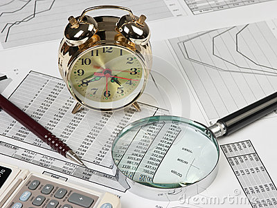 Gold clock and office supplies