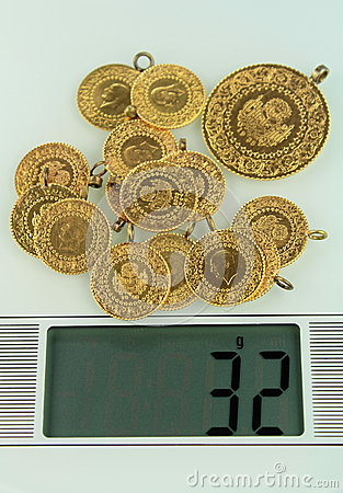 Gold coins on a jewelery scale