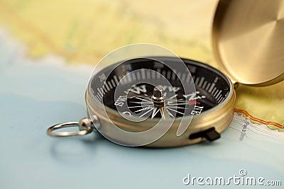 Gold compass & map