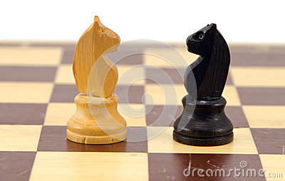 Gold crocodile nut crush tool on chess board