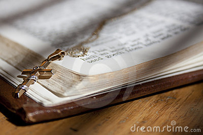 Gold Cross on Holy Bible
