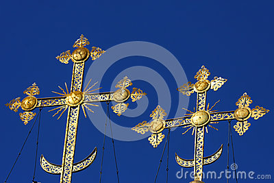 Gold crosses on blue skies