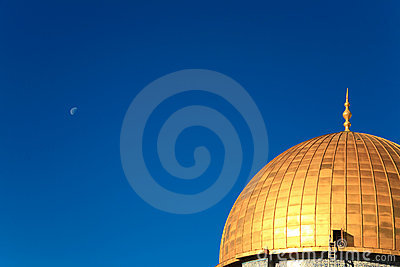 Gold cupola on the background of bright blue sky
