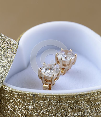 Gold earrings stud with diamonds