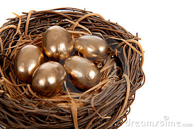 Gold eggs in a nest on a white background