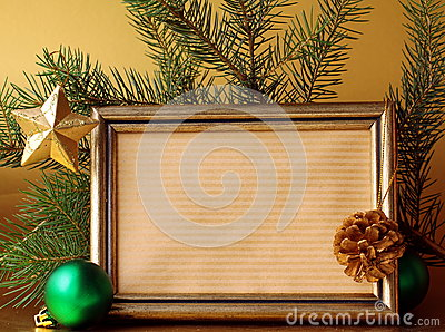 Gold frame and Christmas decorations