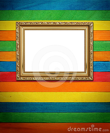 Gold frame on colorful wood