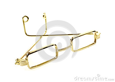 an angle view of a pair of rectangular frame gold rim doll glasses