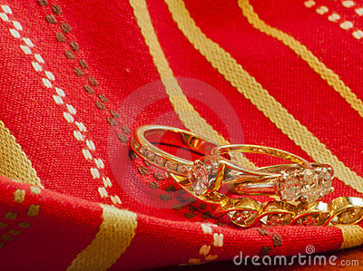 Gold on Gold--Rings and Bracelet Intertwined