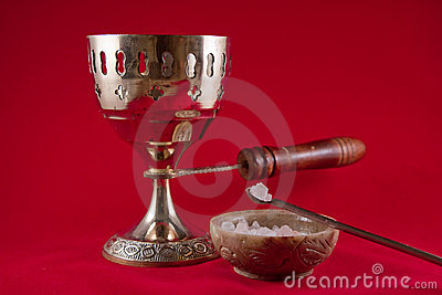Gold incense chalice on red velvet background