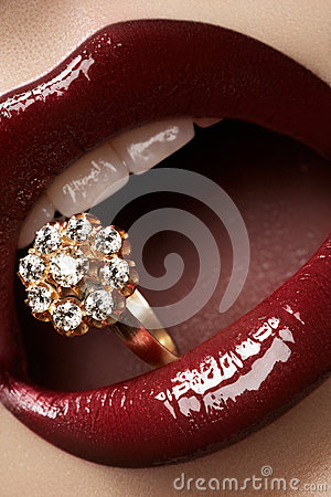 Gold jewelry. Fashion lips make-up & diamond ring