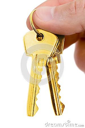 Gold key in fingers