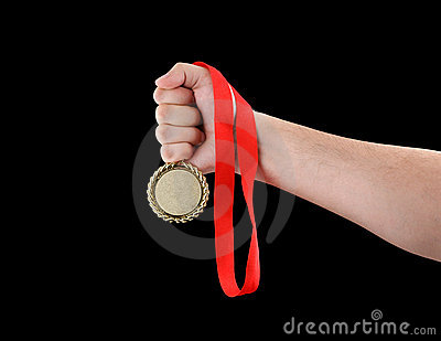 Gold medal in hand isolated