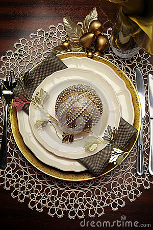 Gold metallic theme Christmas  formal dinner table place setting - vertical.