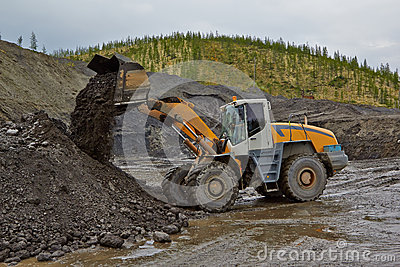 Gold mining in Susuman. The auto-loader works Editorial Photography