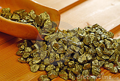 Gold nuggets and  wooden  scoop