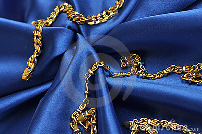 Gold over blue satin