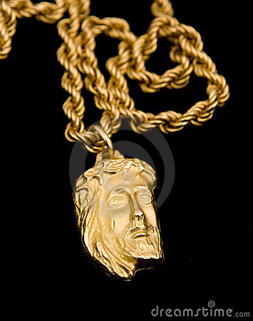 Gold pendant in shape the face of Christ