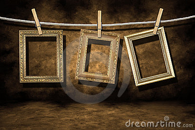 Gold Photo Frames on a Distressed Grunge Backgroun
