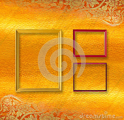 Gold and red picture frame .