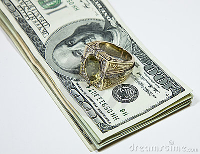 Gold ring on dollar bills