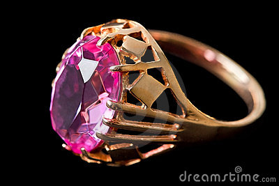 Gold ring with pink stone