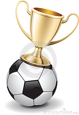Gold shiny trophy cup on  top of soccer ball
