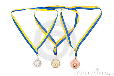 Gold, silver, and bronze medals isolated on white