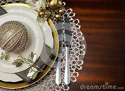 Gold theme Christmas dinner table setting, with copy space for your text here.