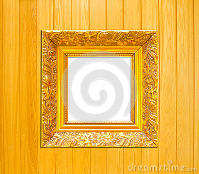 Gold Vintage picture frame on wood background
